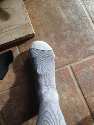 place sock over toe caps pads and footbed